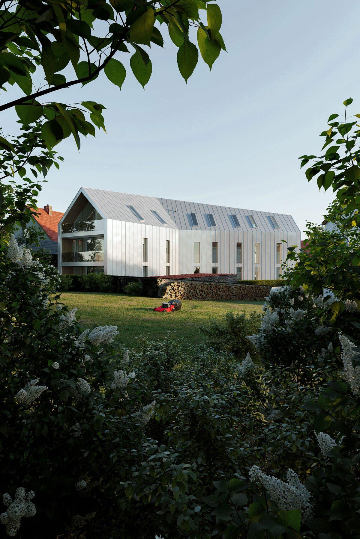 Perspektive von der Gartenseite auf das Mehrfamilienhauses in der Oberpfalz.